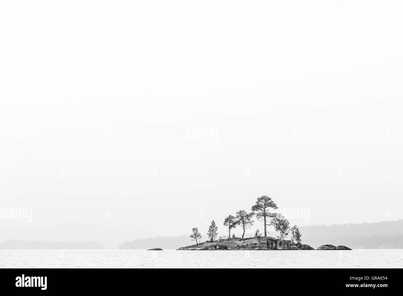 Black And White Photo Of A Remote Island In Lake Inari In Northern Finland With Lots Of Copy Space - Stock Image