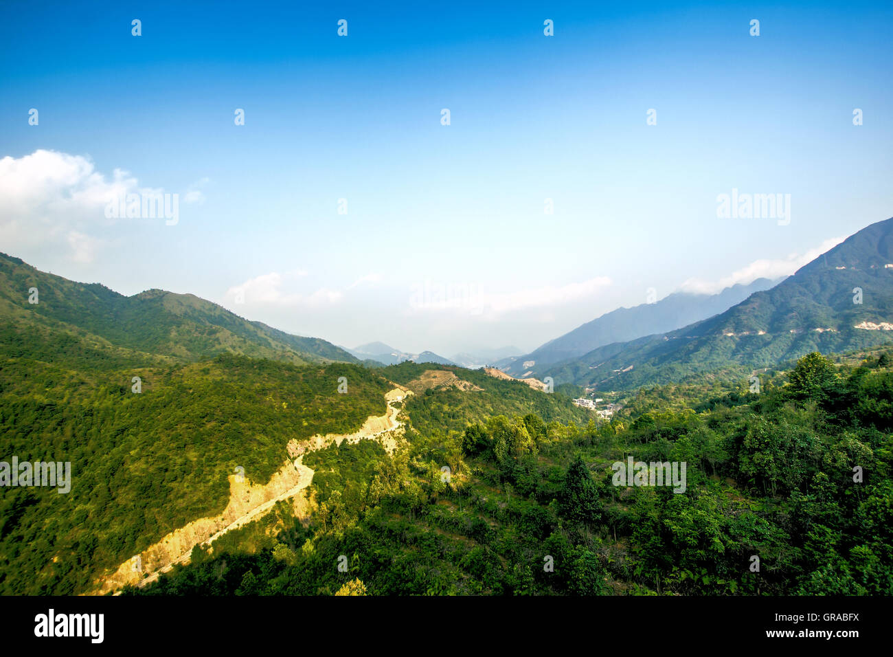 Blue sky and white clouds Castle Peak natural scenery - Stock Image