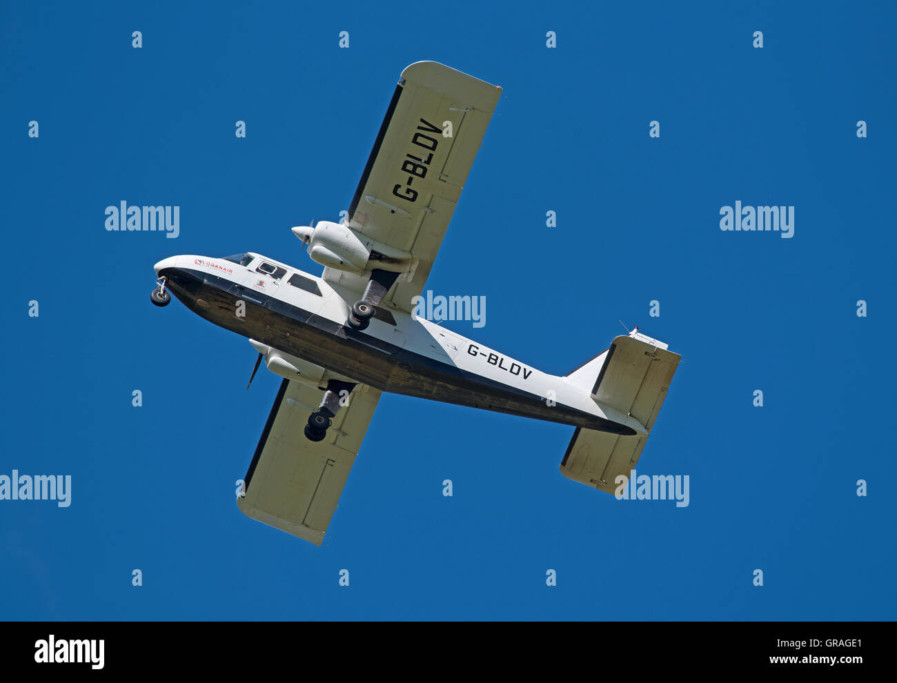 Britten-Norman BN2B-26 Islander twin engine light propellor aircraft operated by Loganzir in Scotland.  SCO 11,227. - Stock Image