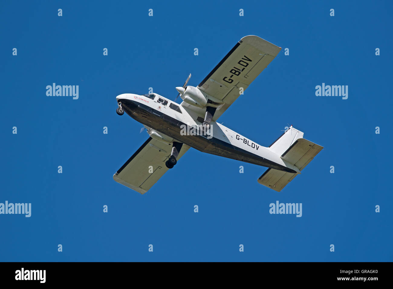 Britten-Norman BN2B-26 Islander twin engine light propellor aircraft operated by Loganzir in Scotland.  SCO 11,228. - Stock Image