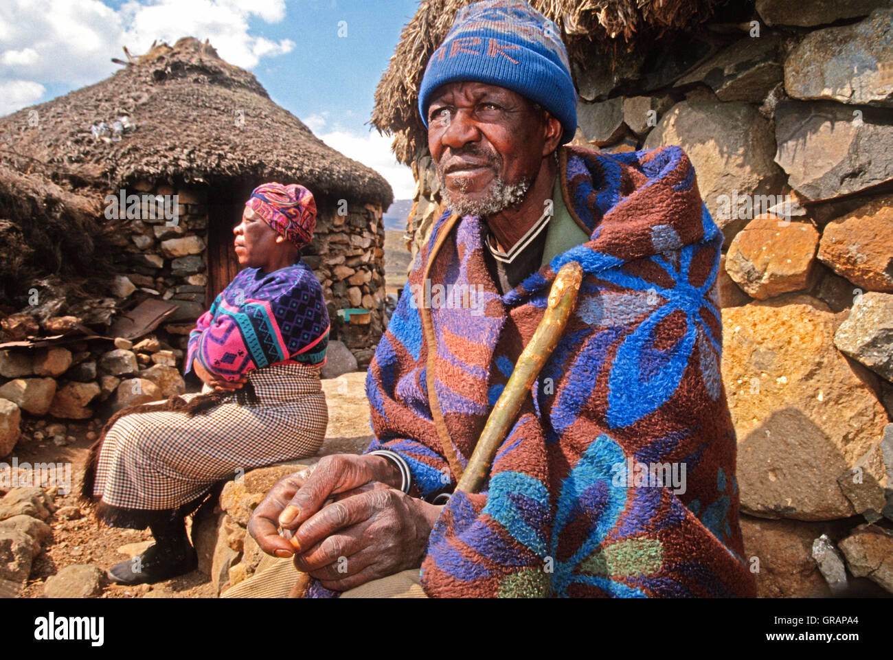 Elderly Basotho couple by their rondavels at Sani Pass in Lesotho - Stock Image