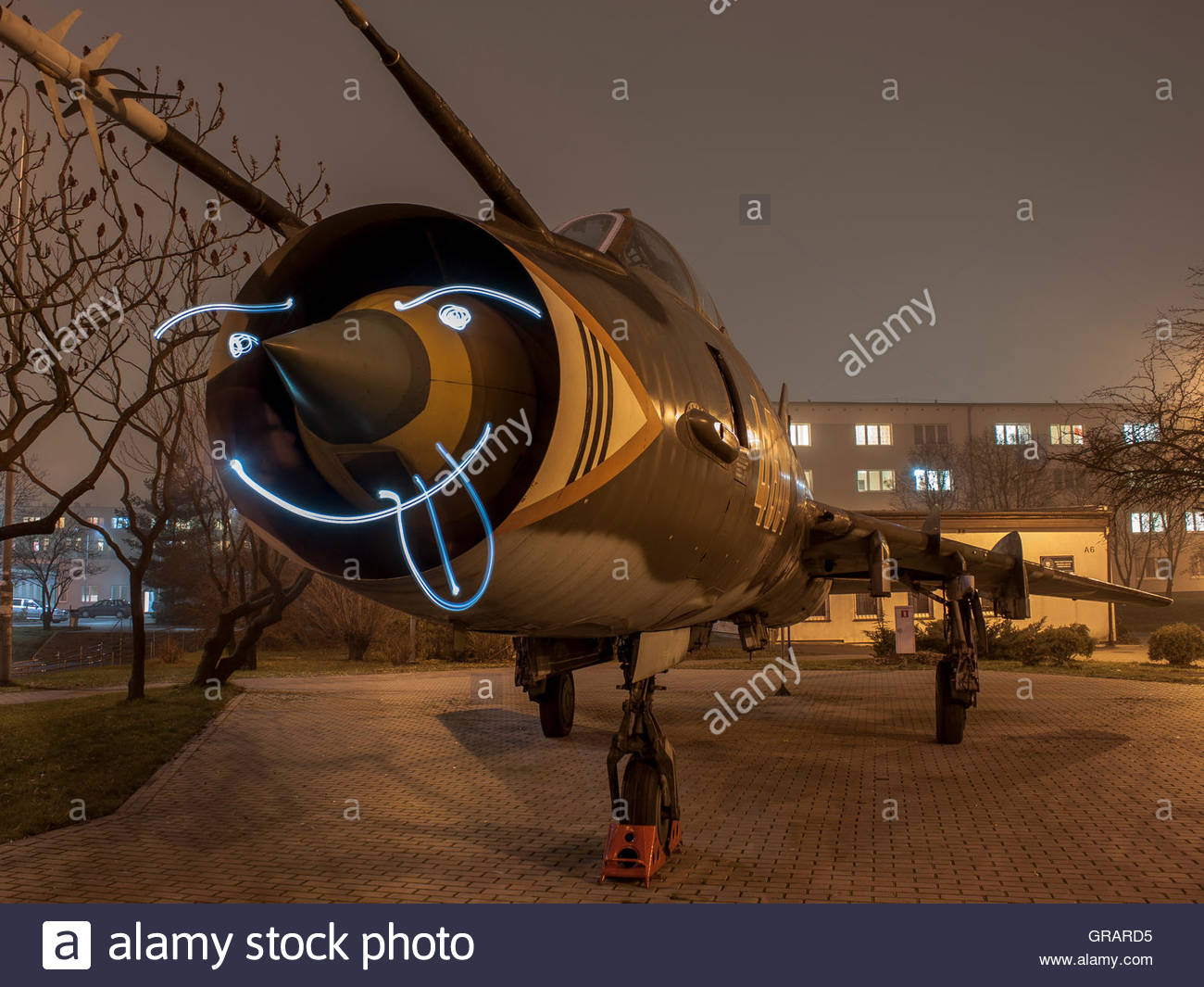 Light Painting On Military Airplane Against Sky - Stock Image