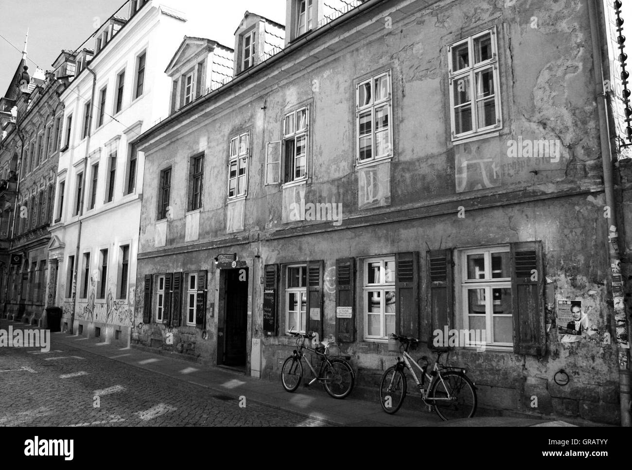 Bicycles Parked On Sidewalk Against Buildings Stock Photo