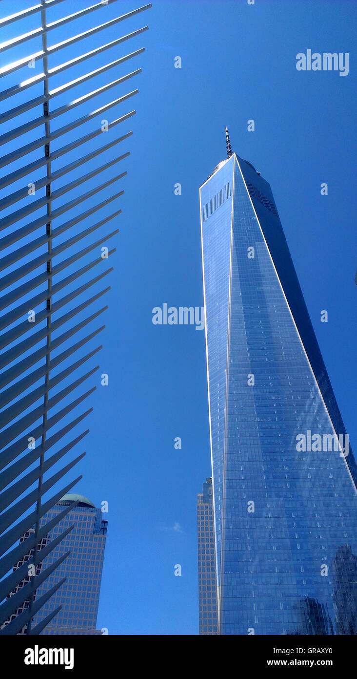 World Trade Center Tower One next to the Transportation Hub Oculus. - Stock Image