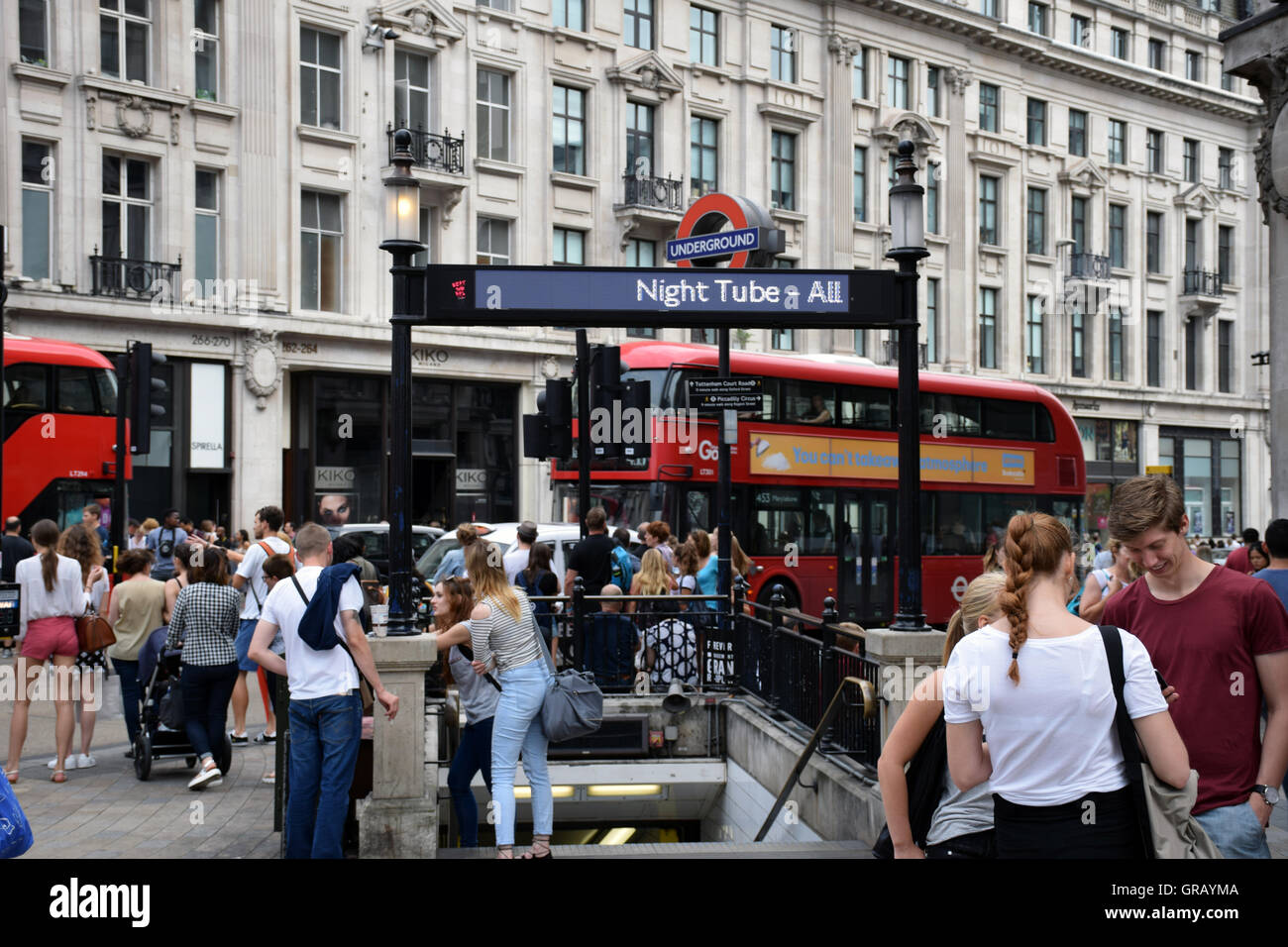 Oxford Circus underground station, London UK. Sign promoting the new all night service on the Victoria Line, August - Stock Image