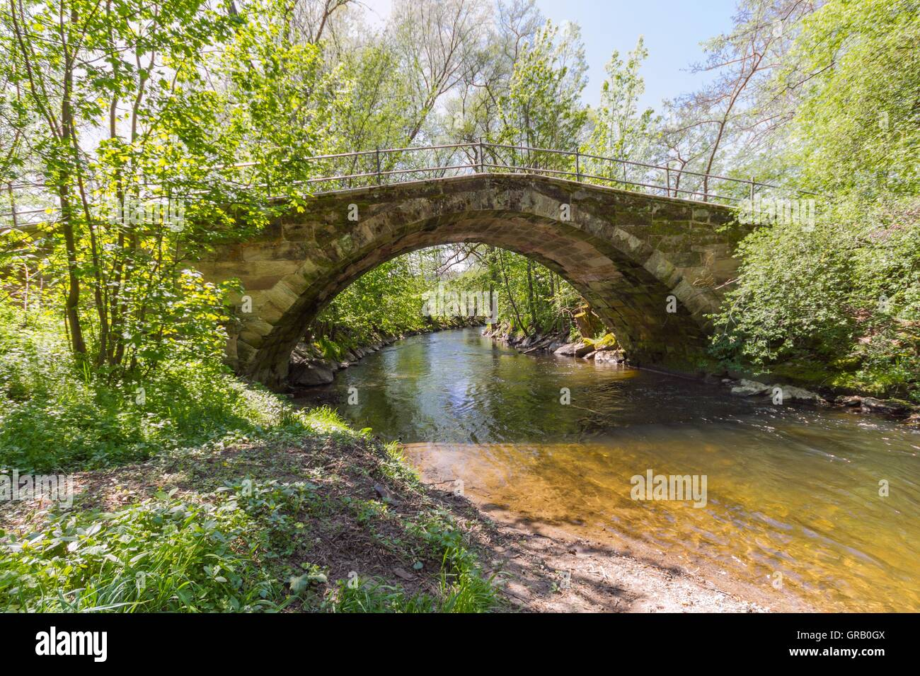 Restored, Historic Arch Bridge From The 17Th Century On The White Main At The Beginning Of The Baille-Maille Lime - Stock Image