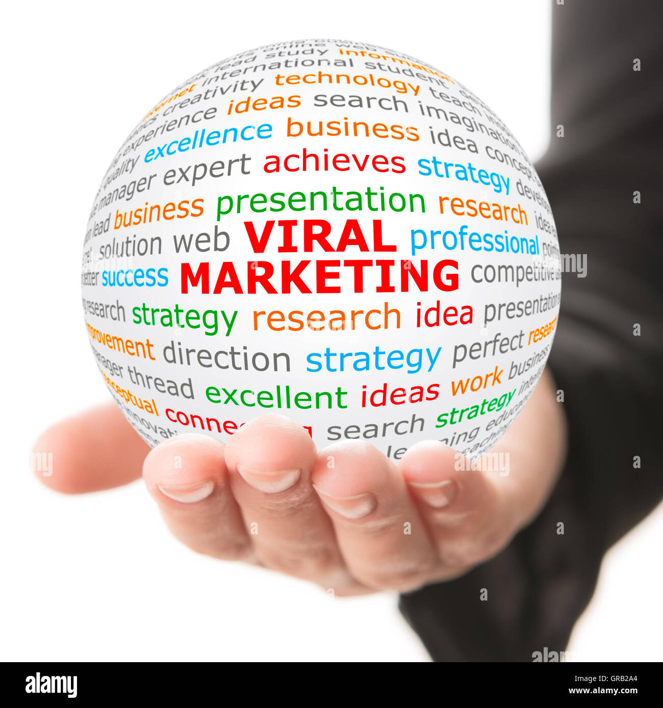 Hand take white ball with red inscription Viral Marketing - Stock Image
