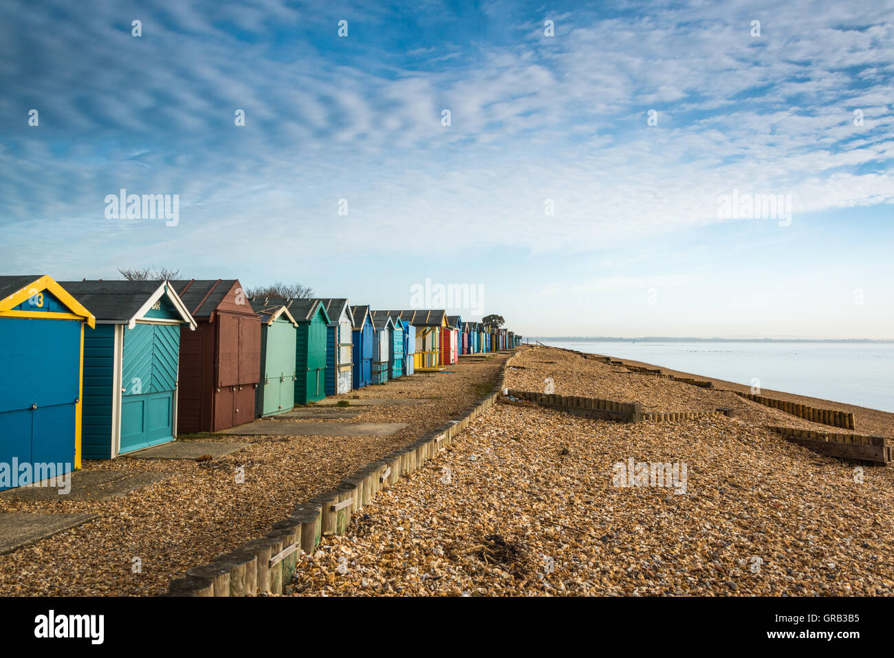 Beach huts on Calshot beach, Hampshire, UK - Stock Image
