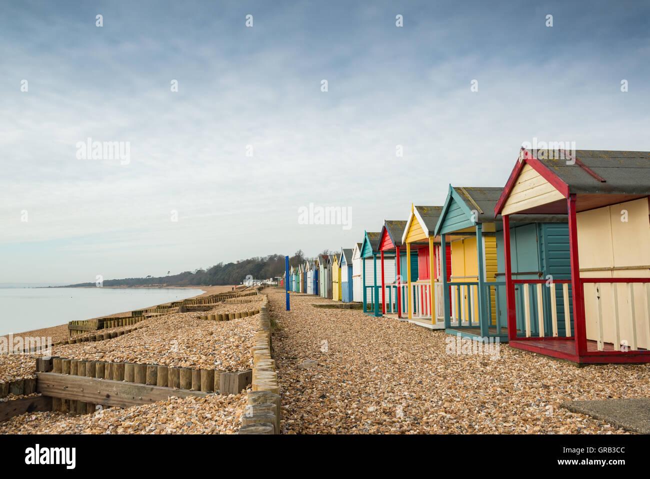 Beach huts on Calshot beach, Hampshire, UK - Stock Image