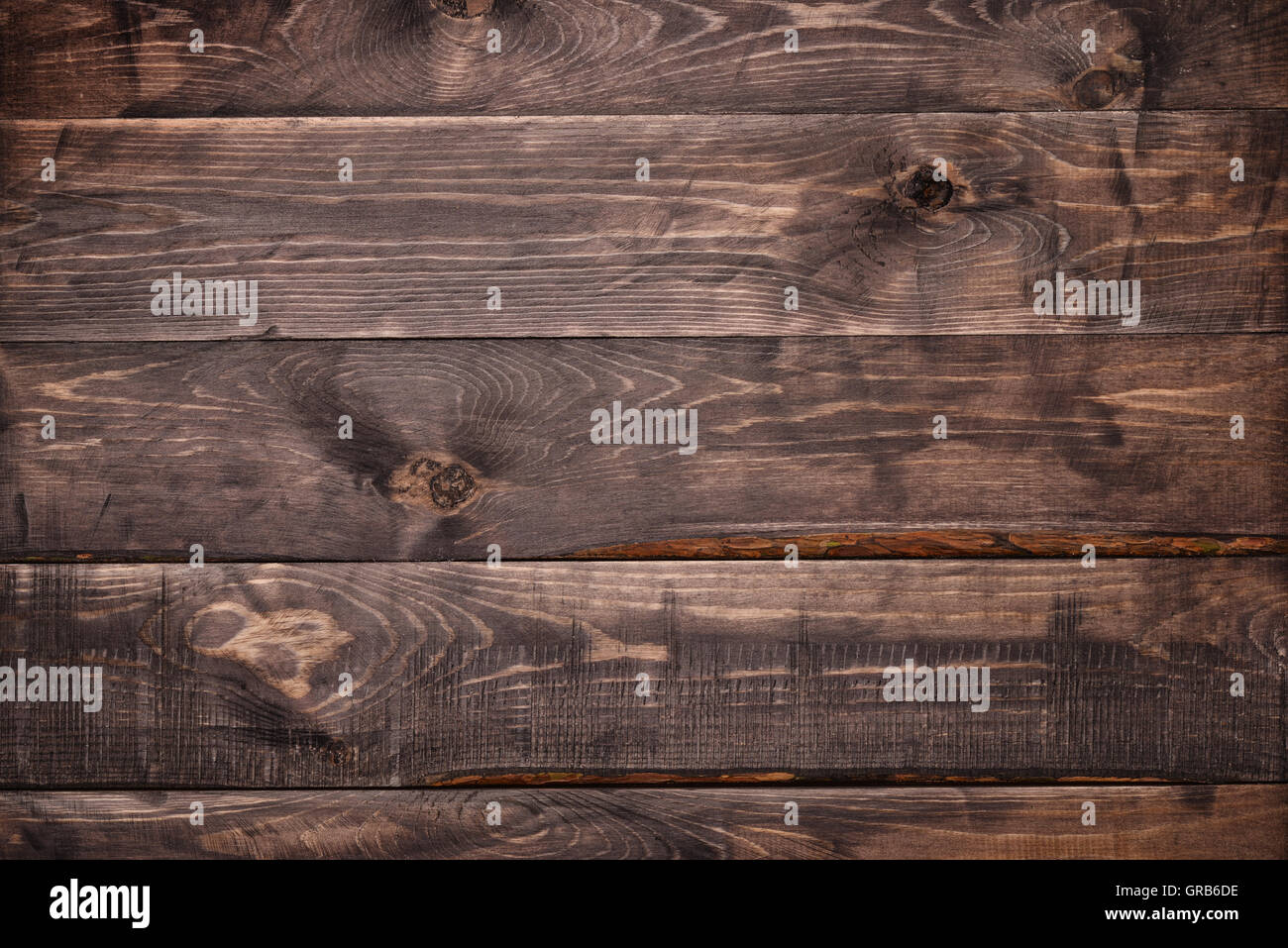 Clse up of dark brown wood plank background - Stock Image