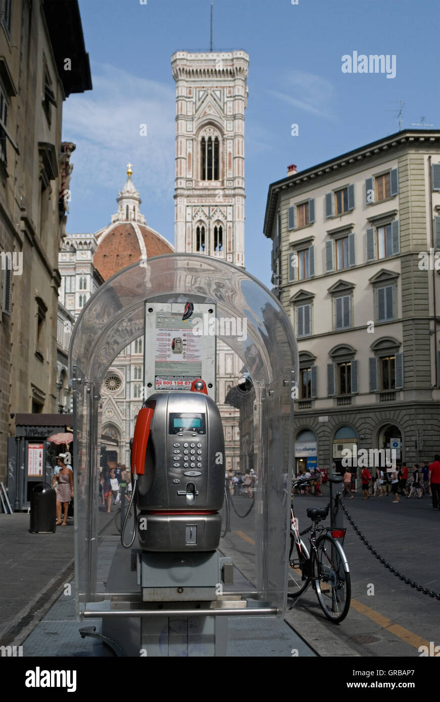 Public Telephone Box And Cathedral In The Background Florence - Stock Image