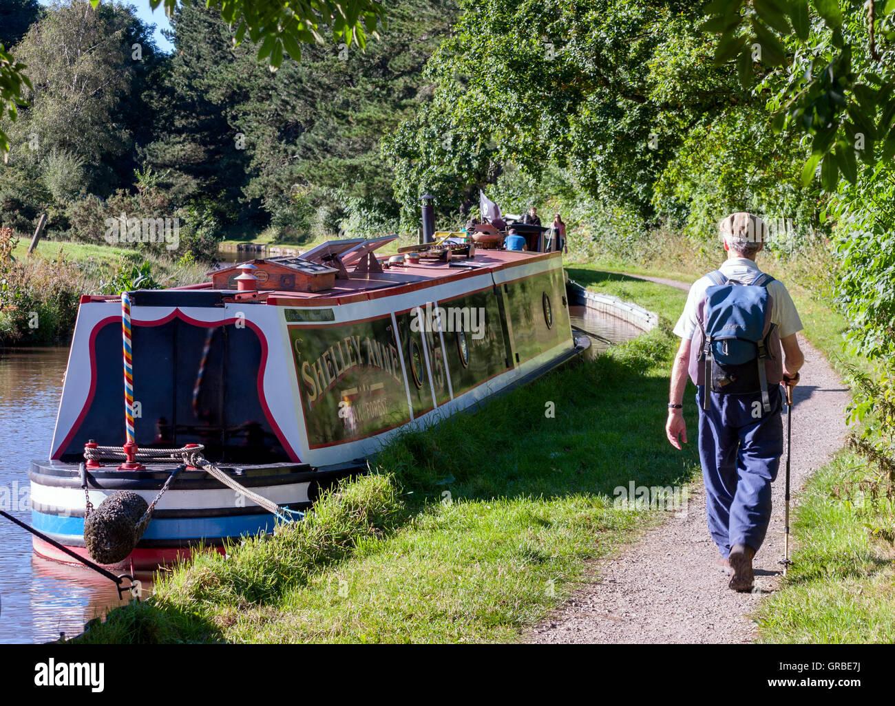 Senior Man Walking Along Canal Towpath - Stock Image