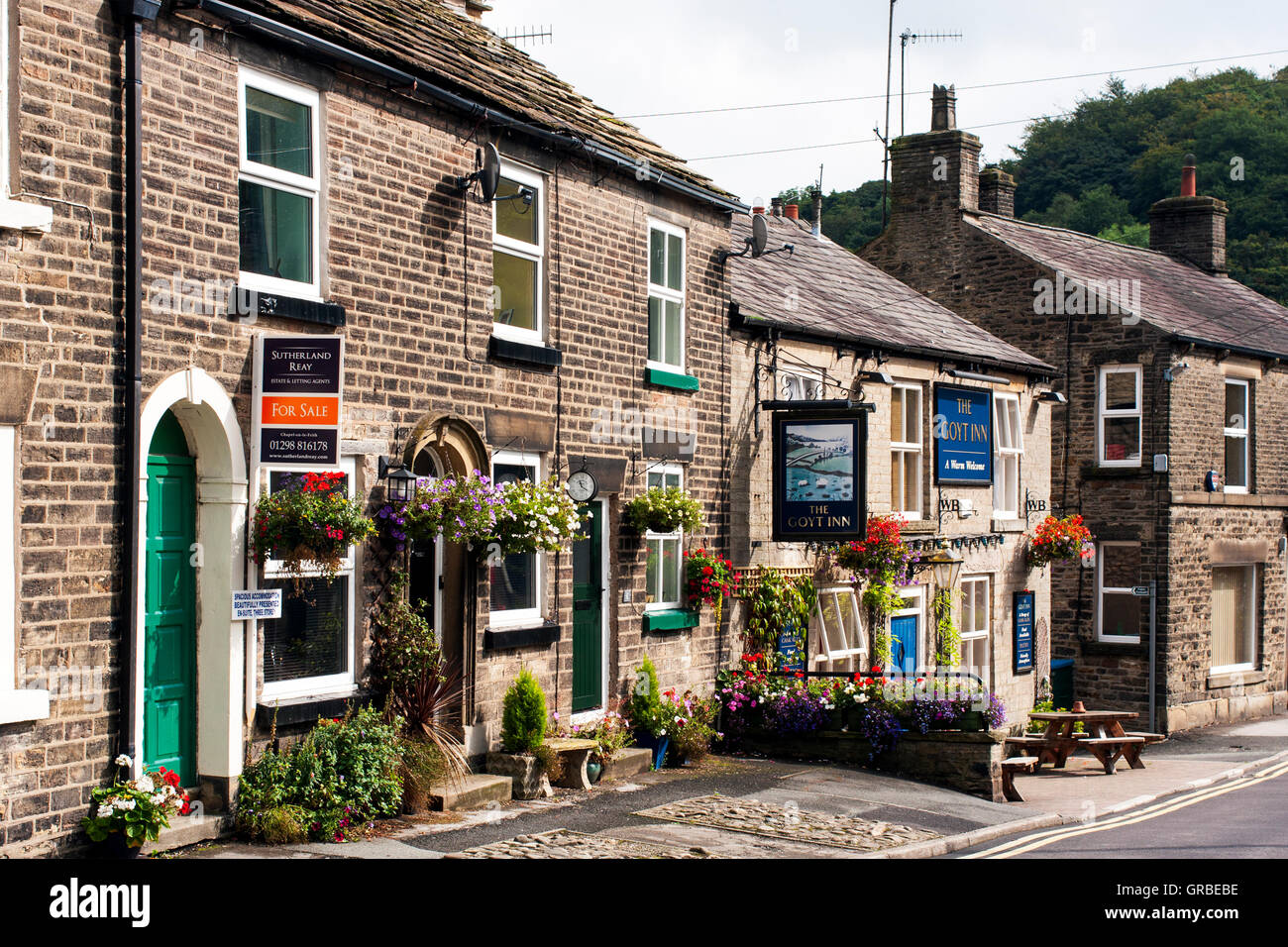 Whalley Bridge Derbyshire. Road with Pub and House for Sale - Stock Image