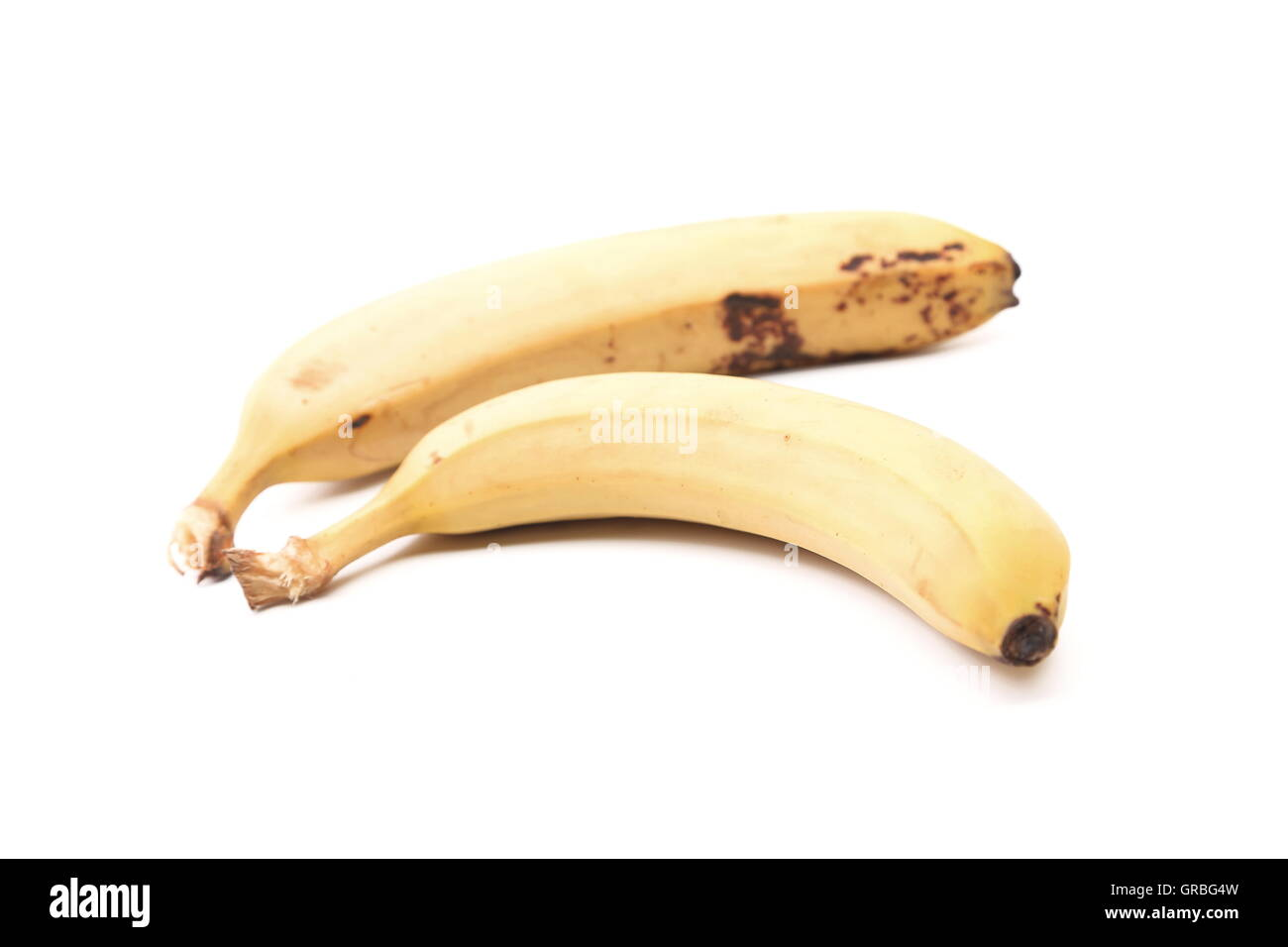 Detail of two old speckled bananas - Stock Image