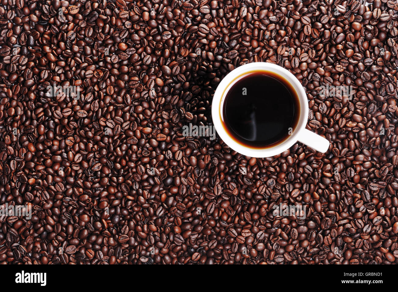 Coffee Bean And Coffee Cup Stock Photo
