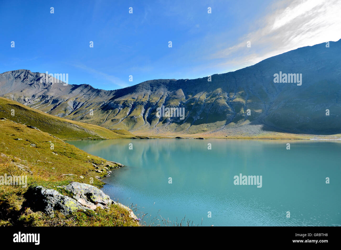 Lac Goléon Appears In Deep Turquoise Colour With The First Sunlight In Early Morning, French Alps, France - Stock Image
