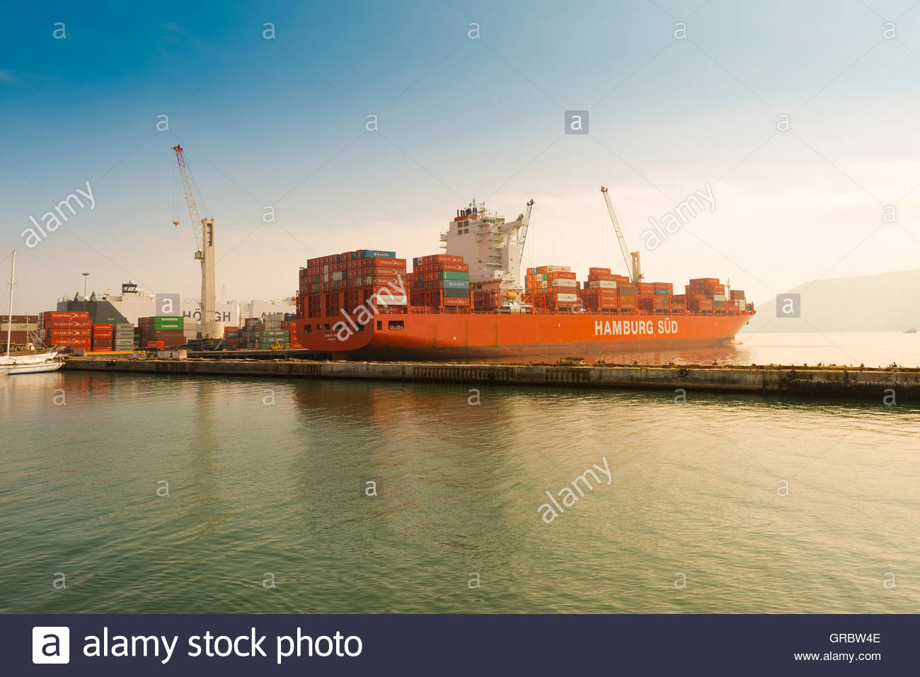 Cargo ship loaded with containers at port of Iquique, Chile - Stock Image