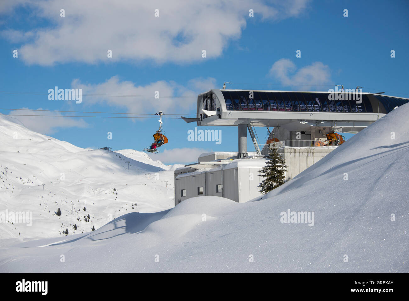 Chairlift Midwaystation In Skiing Area On A Sunny Winterday - Stock Image