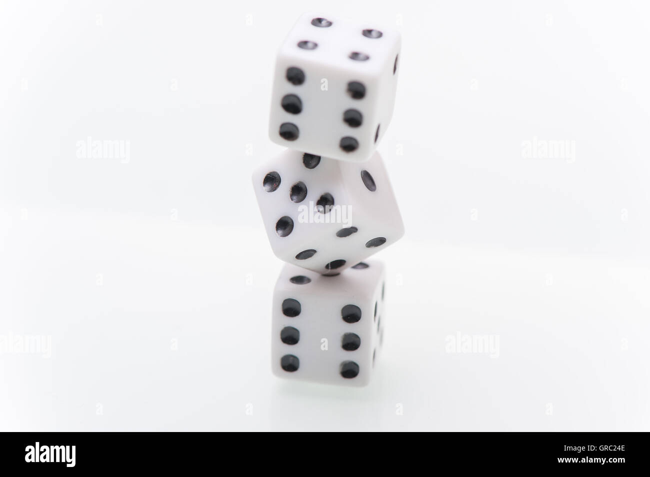 Tower Of 3 White Dice On White Background, Close Up - Stock Image