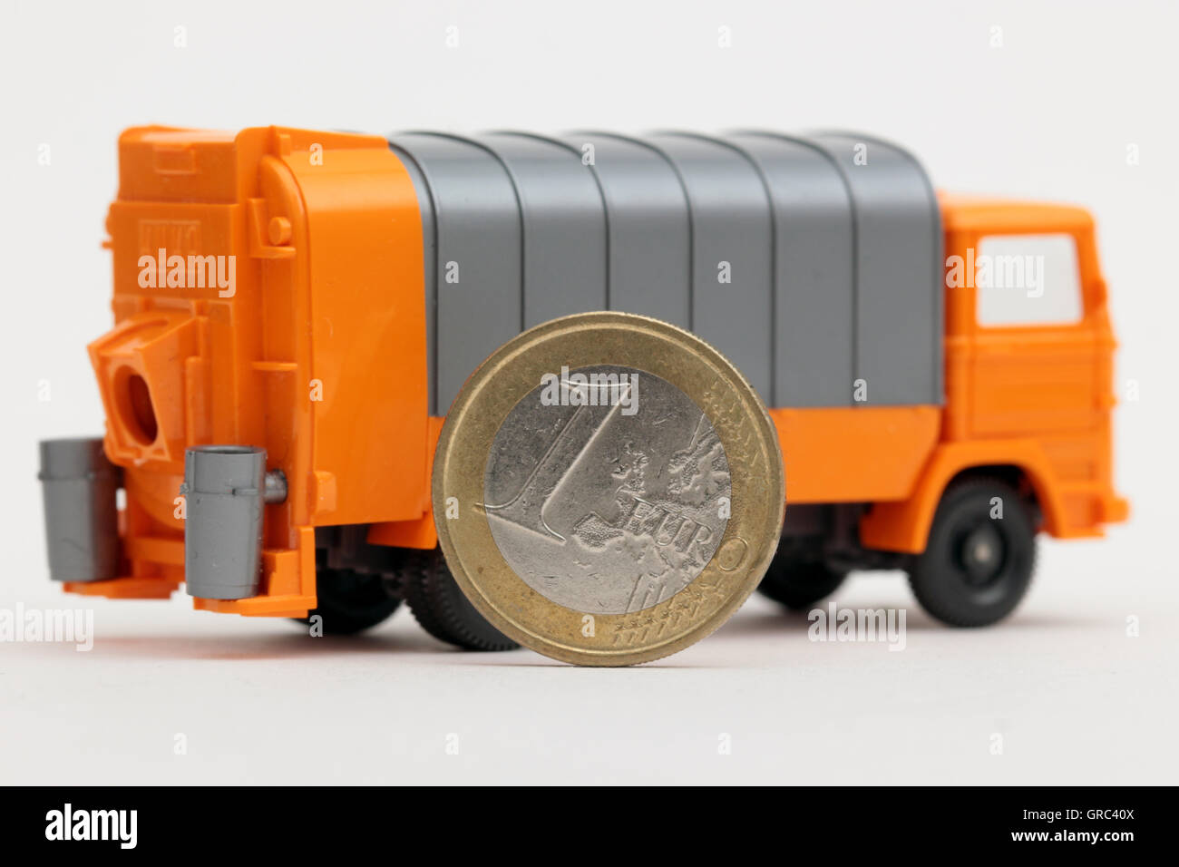 Garbage Truck With Euro Coin Stock Photo