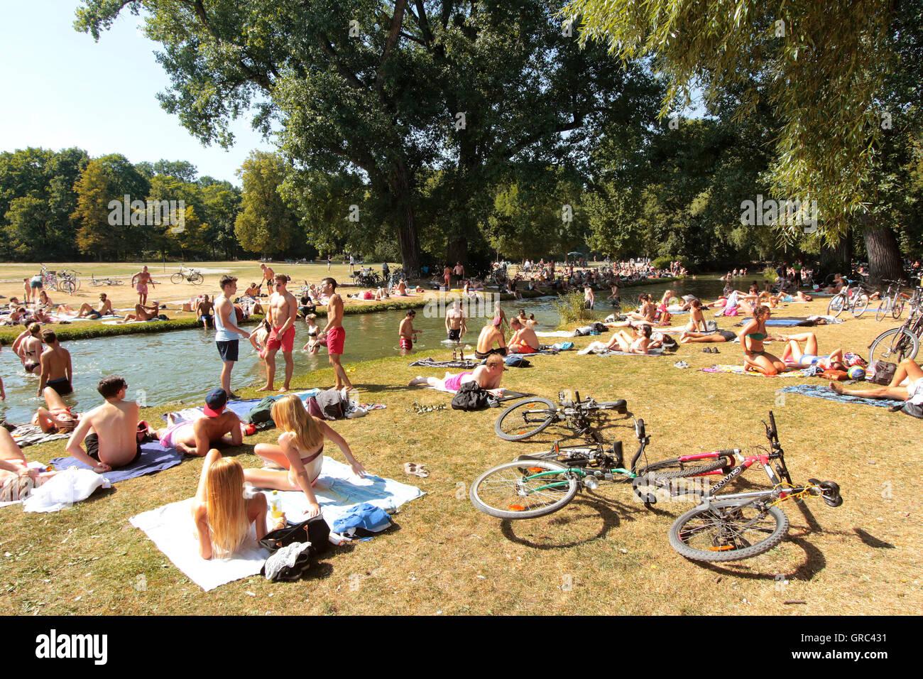 Crowded Lawn During Heat Wave At Englischer Garten In Munich Stock Photo