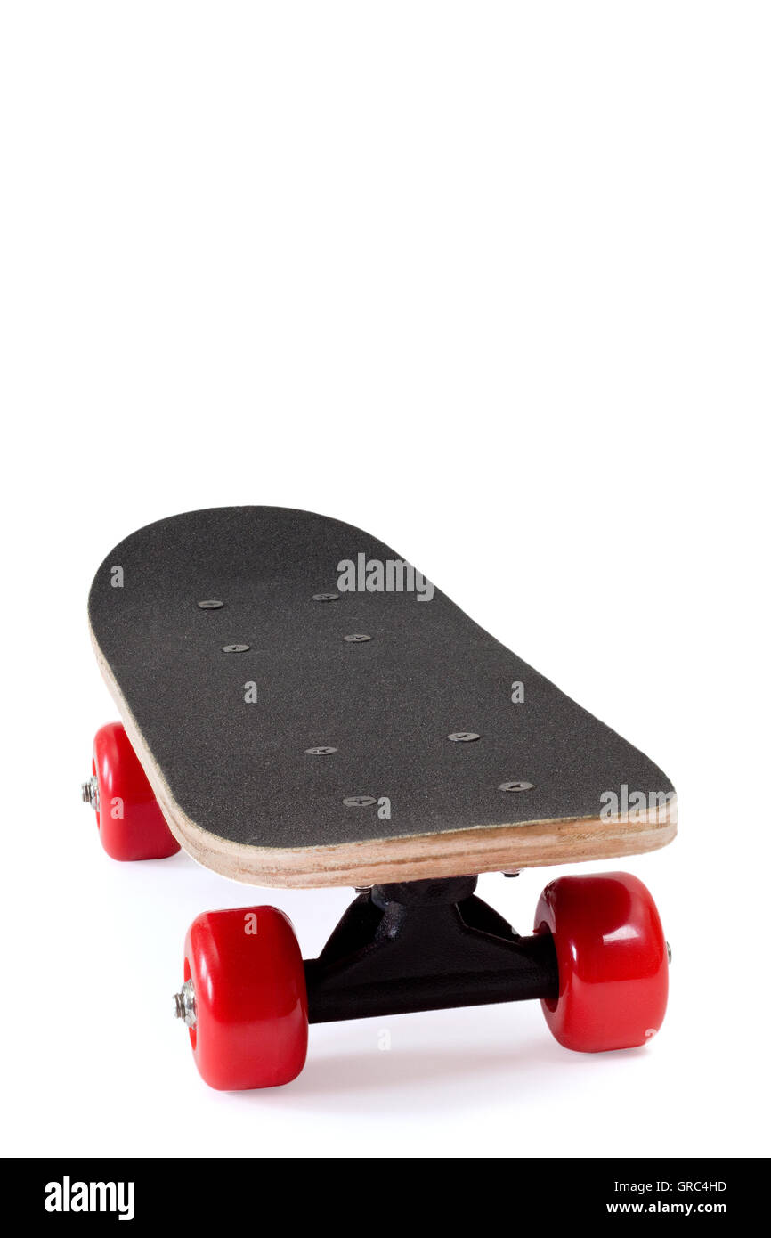 Skateboard With Red Wheels Over White Background   Stock Image