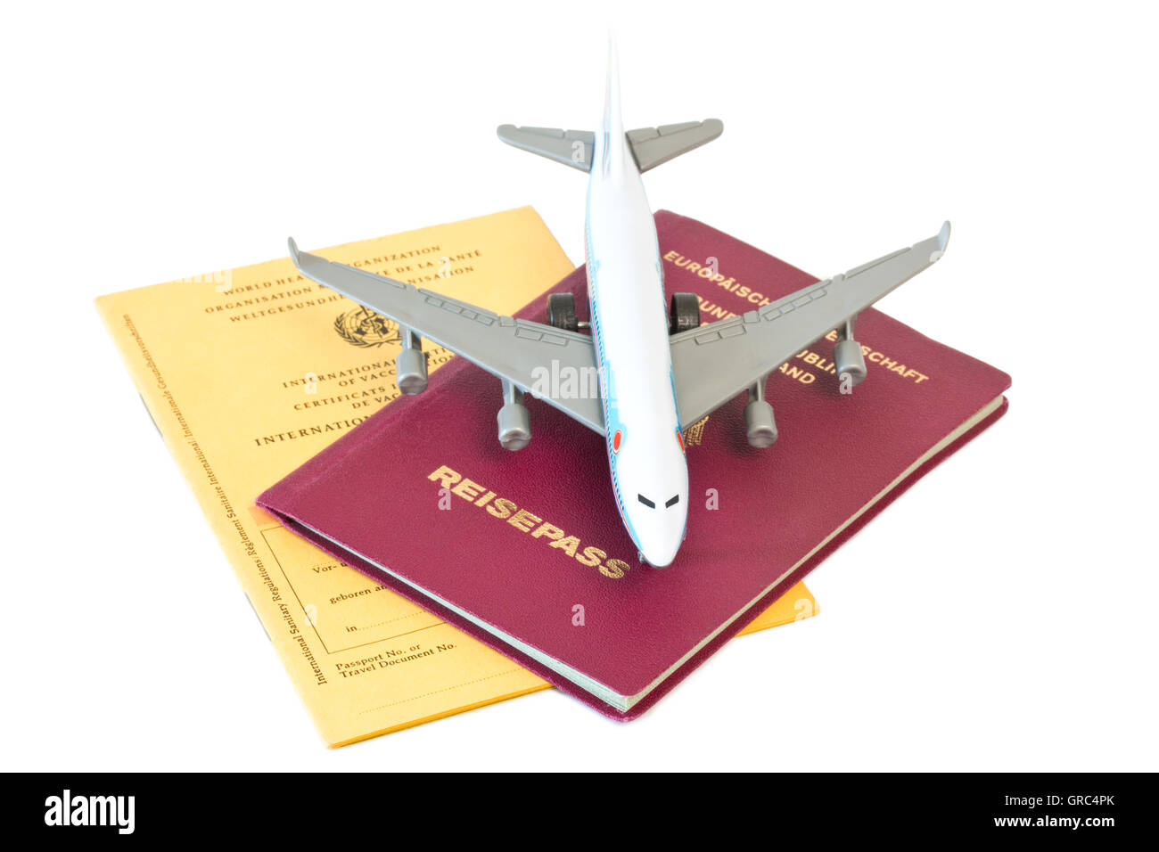 Toy Plane With Passport And Vaccination Card Isolated On White Background - Stock Image