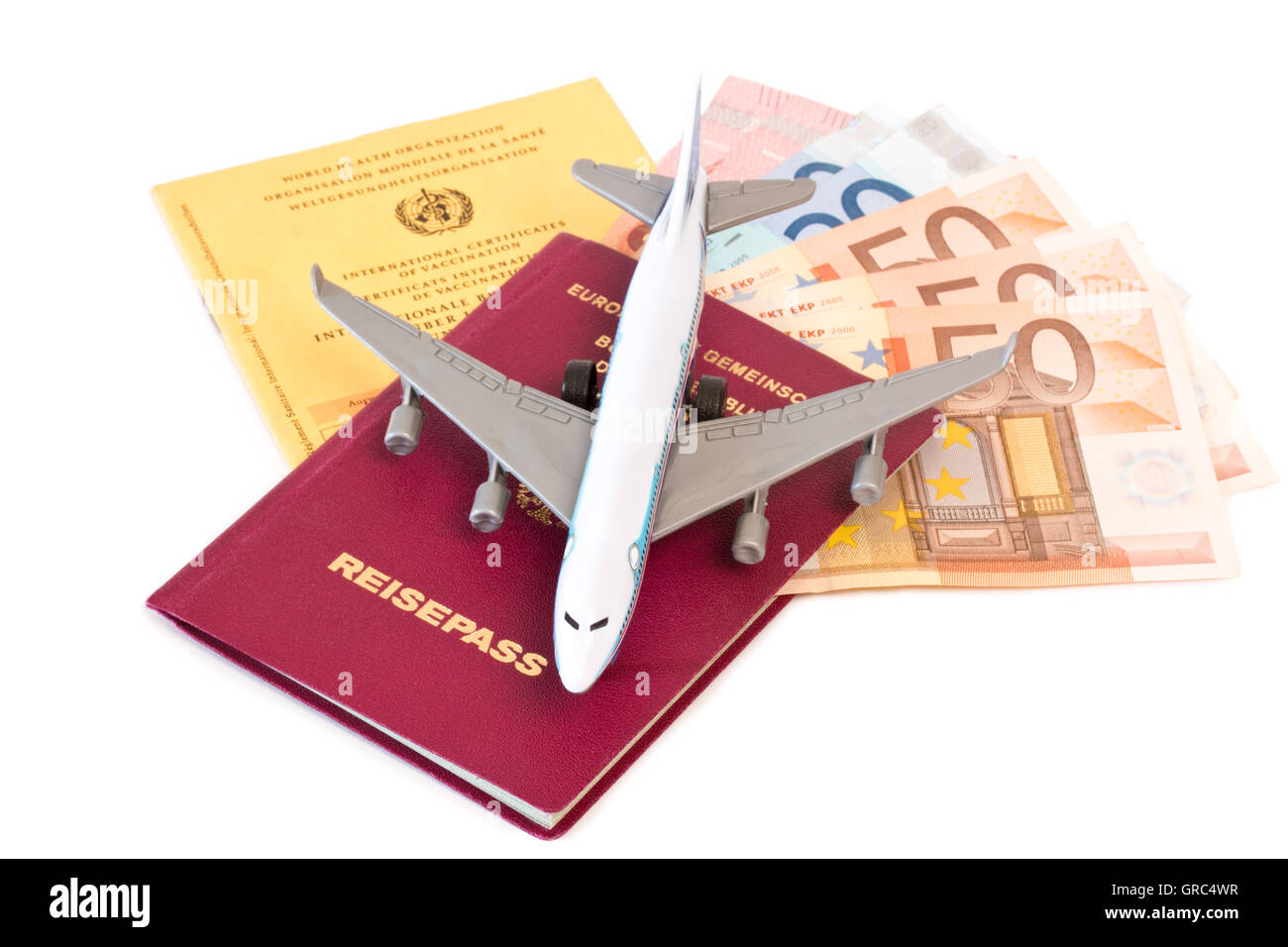 Vaccination Card And Passport With Toy Plane - Stock Image