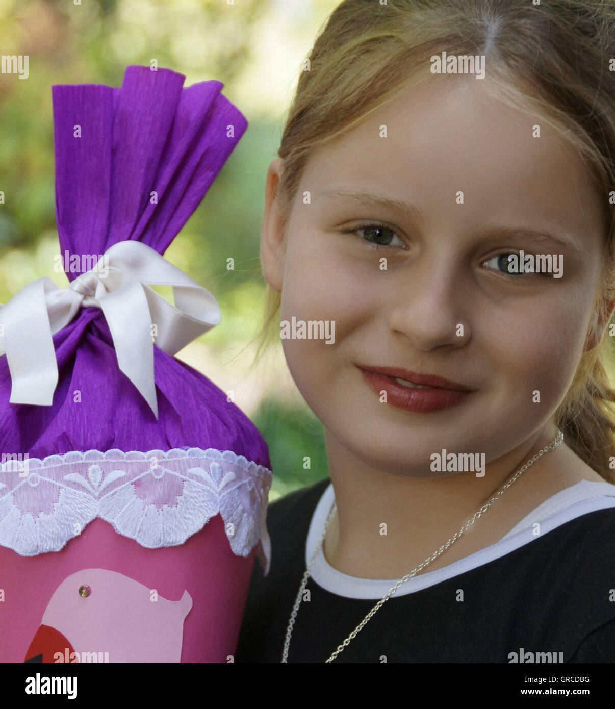 Girl With Large Cornet On The First Day At Junior High School - Stock Image