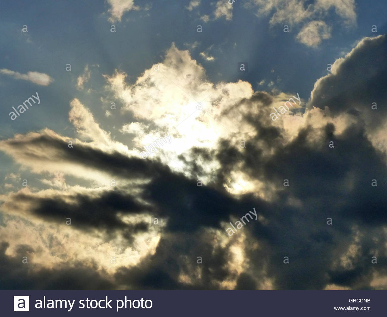 Dark Clouds, And Behind Of Them The Sun Shines - Stock Image