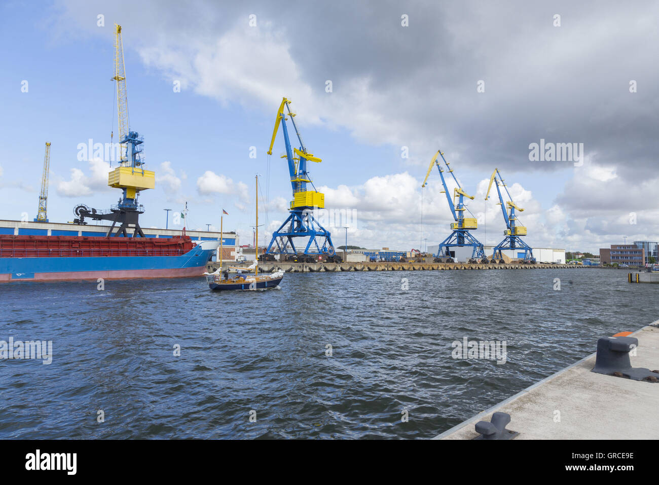 Two Master In Front Of A General Cargo Vessel In The Port Of Wismar Mecklenburg-Vorpommern - Stock Image