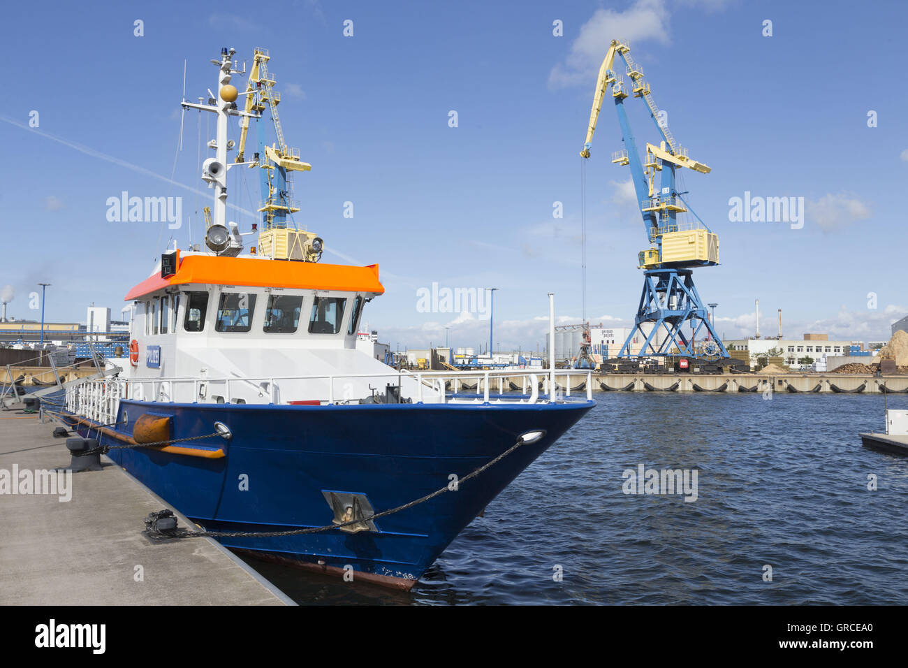 Police Boat In The Industrial Port Of Wismar In The Sunshine - Stock Image