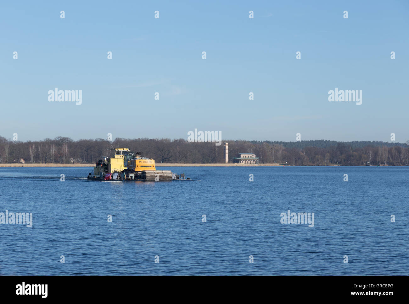 Excavator Is Carried On The Water With A Towboat - Stock Image