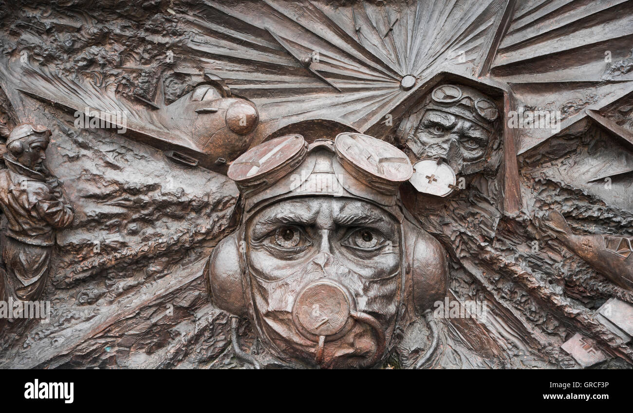 Battle of Britain London Monument  detail of the bronze carving by Paul Day. Showing pilots scramble to their WWII - Stock Image