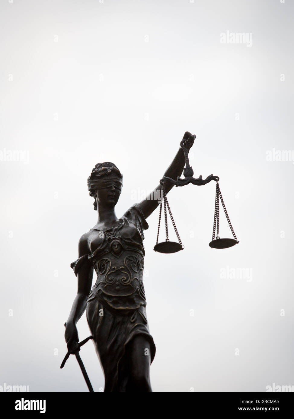 Justitia Against A Neutral Background - Stock Image