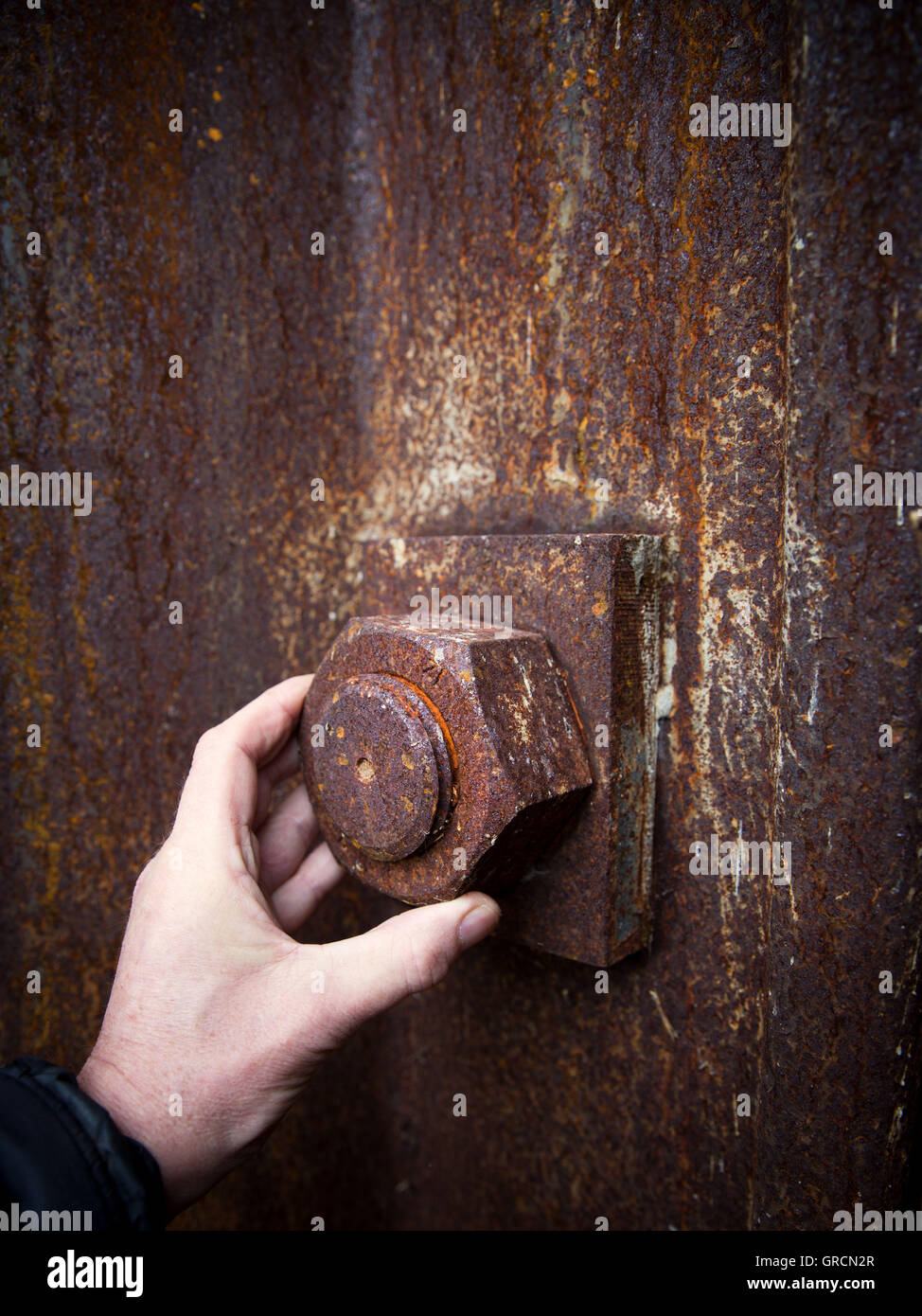 Solve Big Rusty Screw By Hand - Stock Image