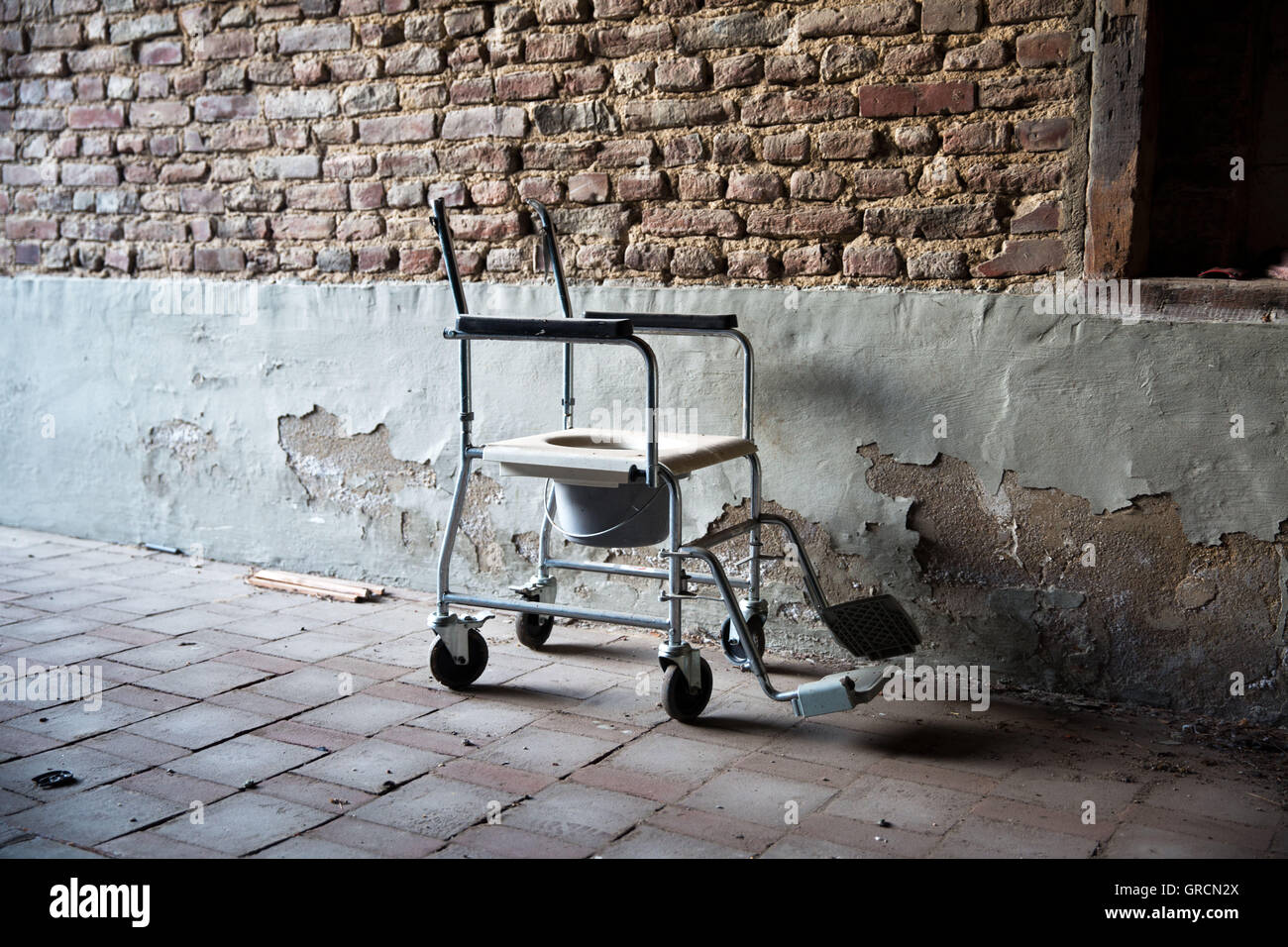 Old Toilet Stool In The Yard Of An Abandoned Nursing Home - Stock Image