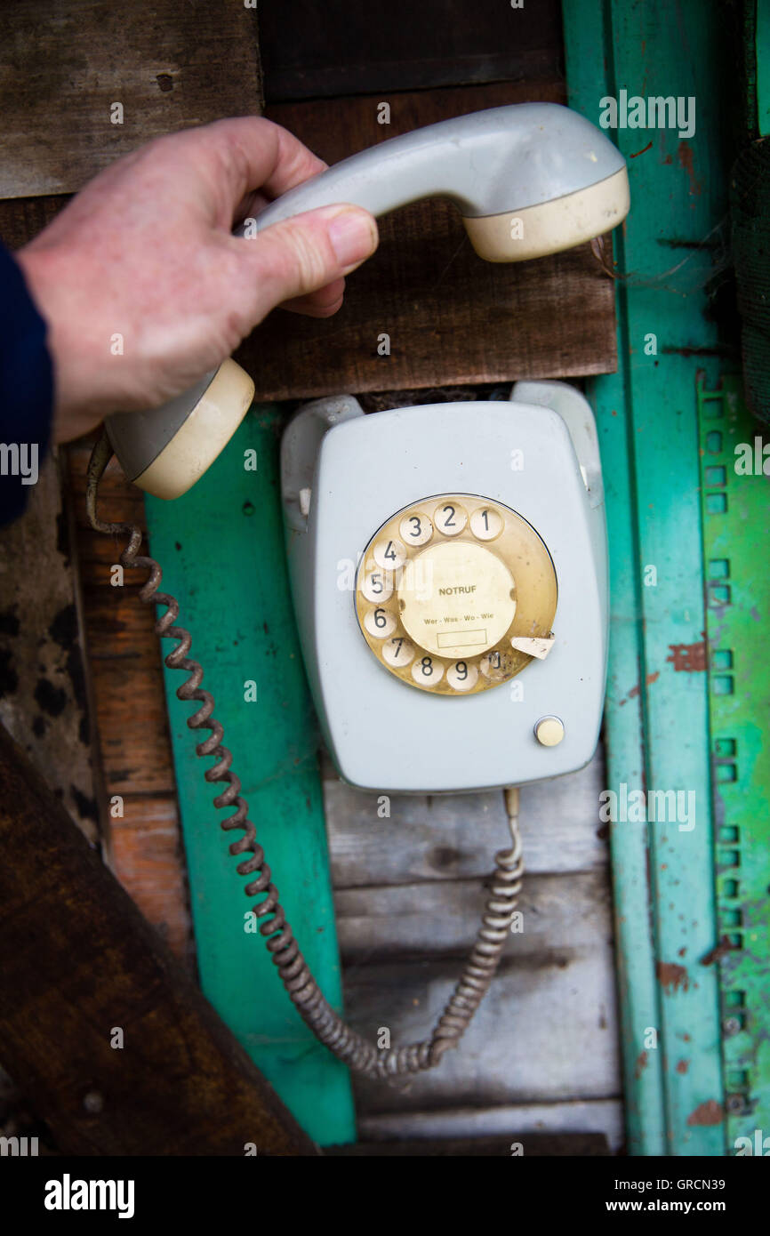 Remove Old Dial Telephone, Wall Telephone, Handset - Stock Image