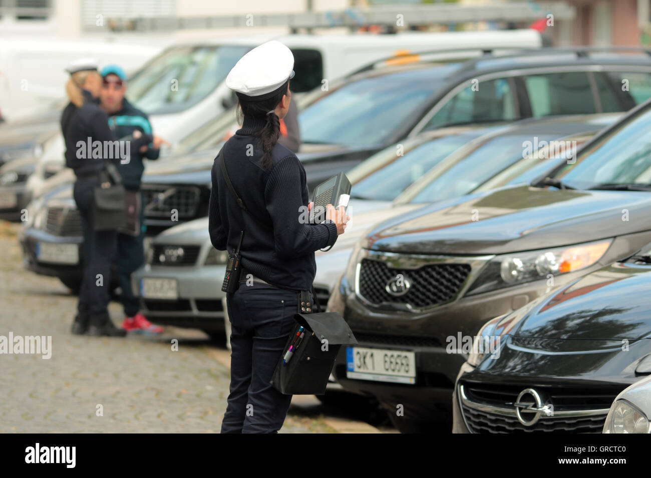 Meter Maids Issuing Tickets For Parking Violation Near Oktoberfest In Munich - Stock Image
