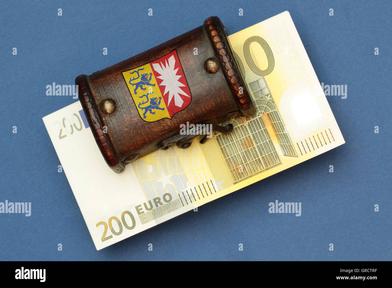 Treasure Chest With Seal Of State Schleswig Holstein And Euro Bills - Stock Image