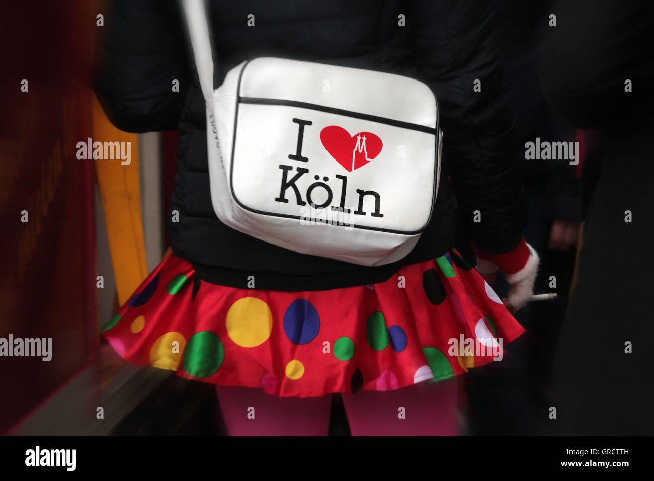 Woman In Miniskirt Carrying A Bag I Love Cologne During Weiberfastnacht - Stock Image
