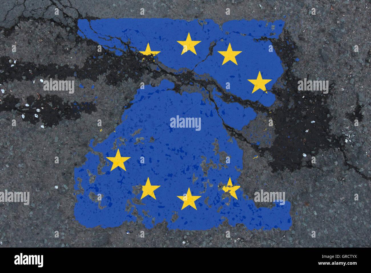 Eu Crisis With Eroding Eu Flag - Stock Image