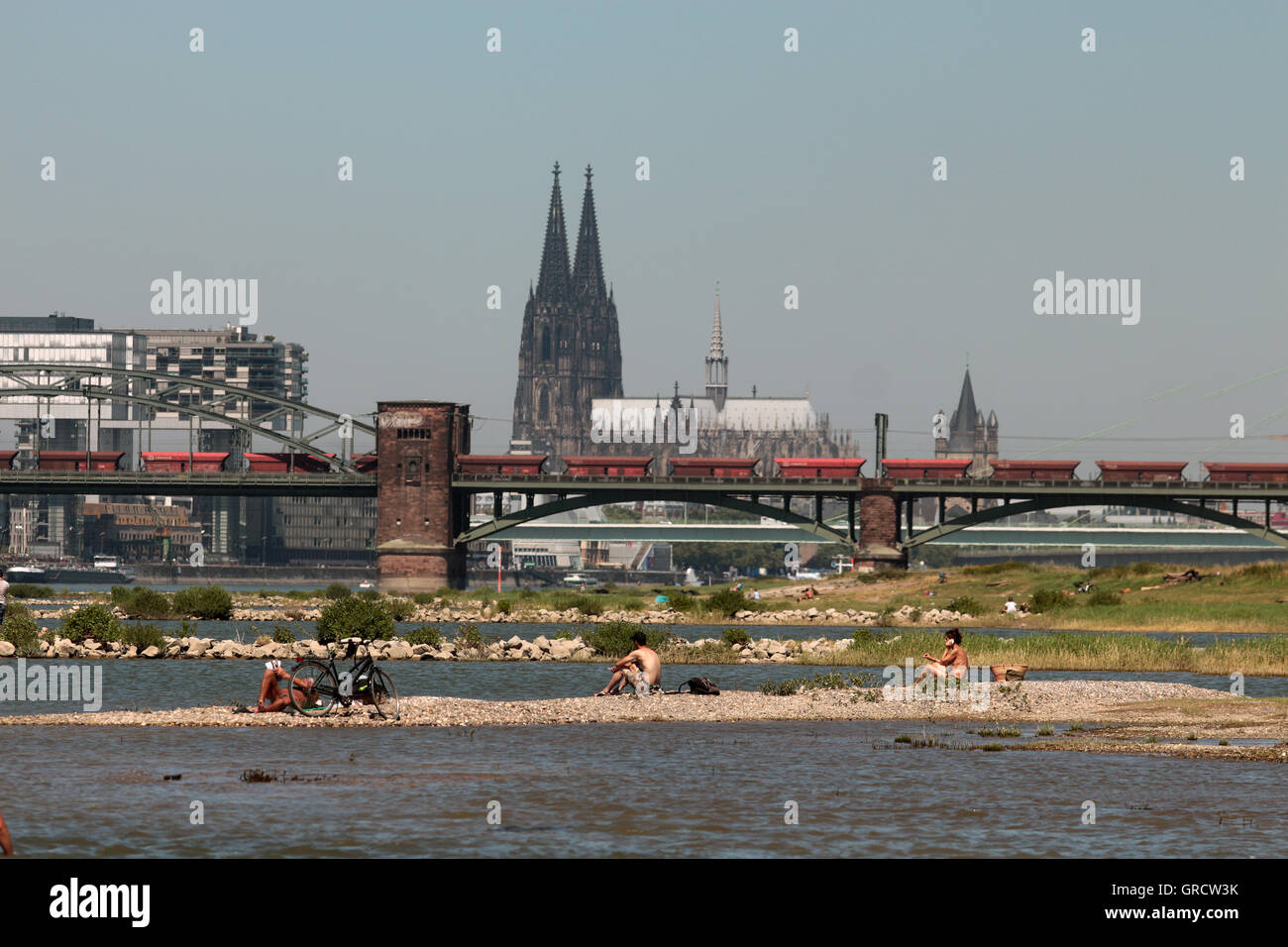 Hot Summer Day At Rhine Shore With Cologne Cathedral - Stock Image