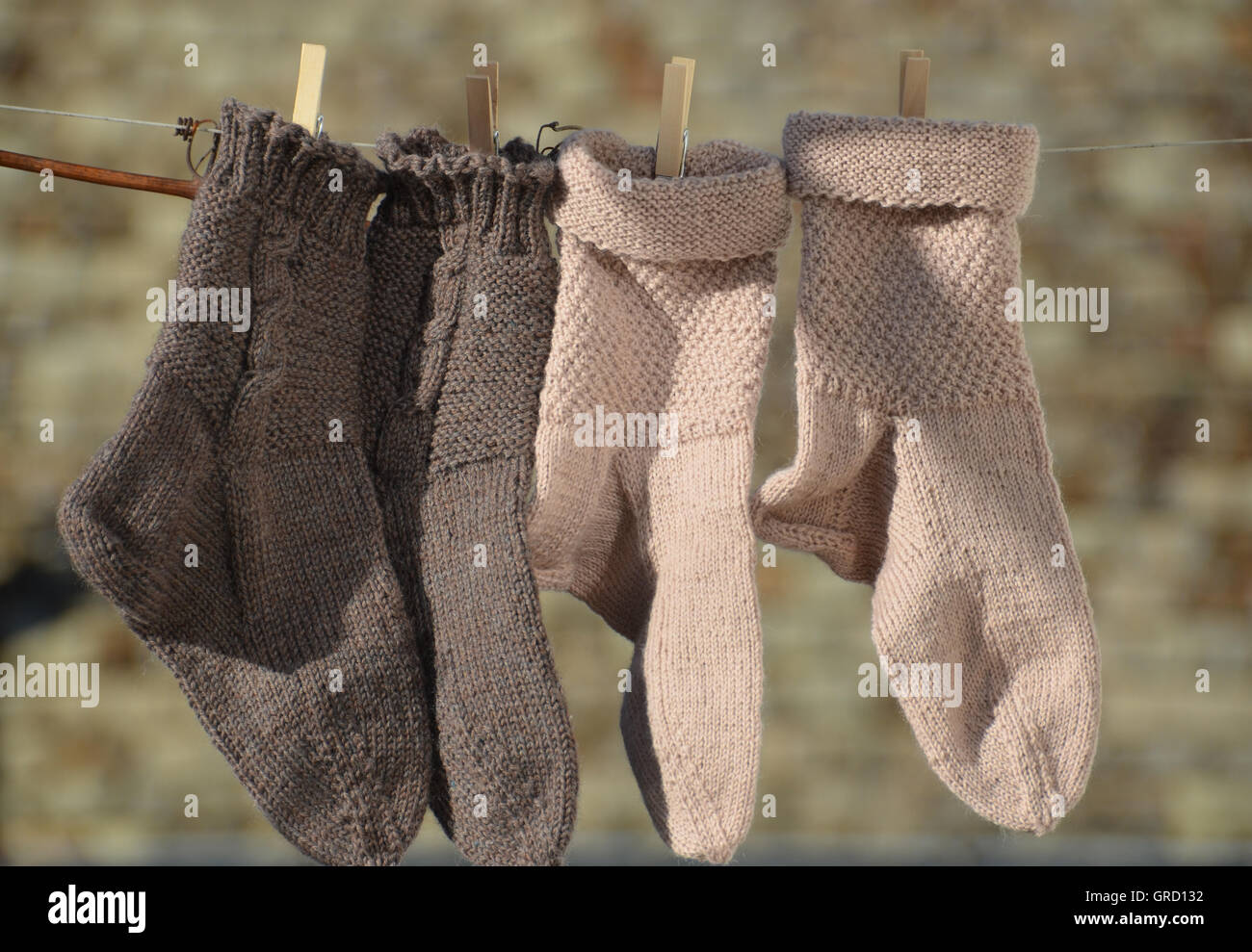 Even Knitted Wool Socks On The Clothesline Stock Photo