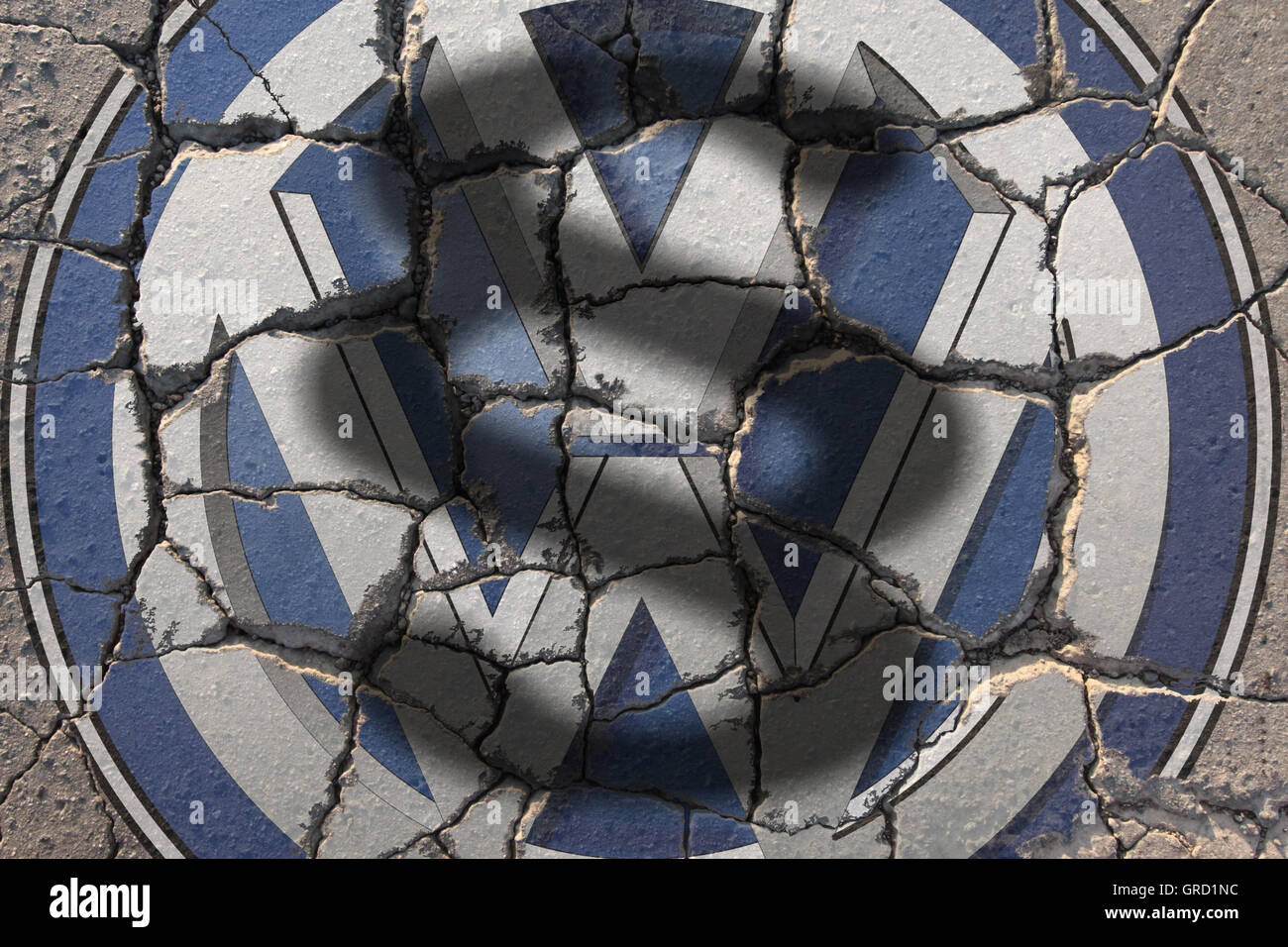 Crisis At Volkswagen Vw Sign On Eroding Road With Paragraph - Stock Image