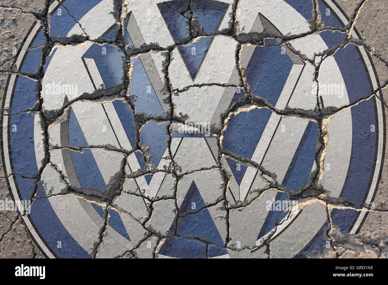Crisis At Volkswagen Vw Sign On Eroding Road - Stock Image