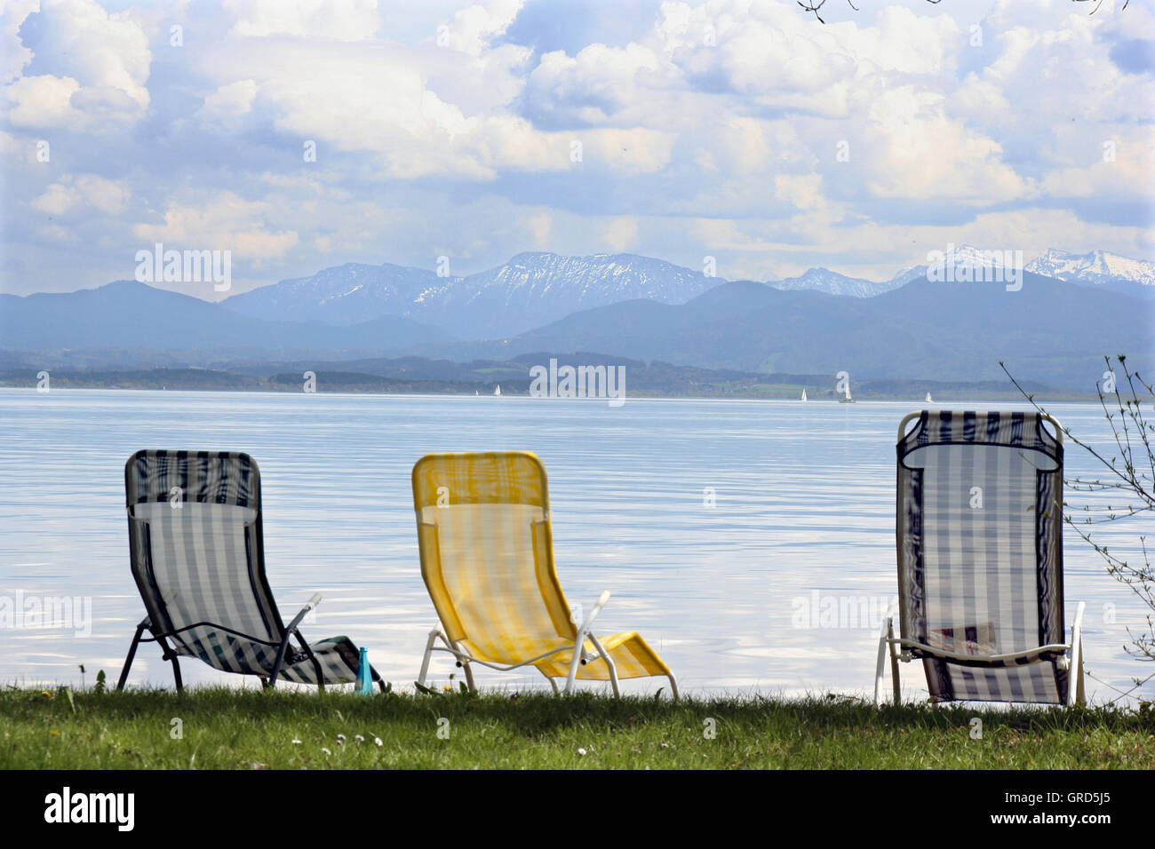 Three Unoccupied Beach Chairs - Stock Image