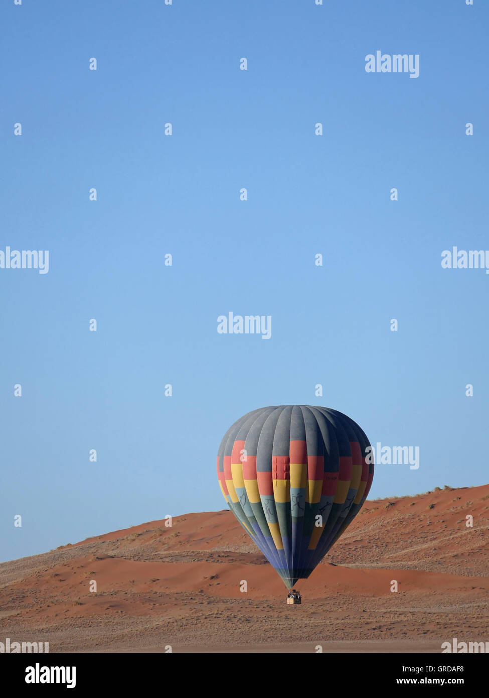 Hot-Air Balloon Flying Over The Namib Desert, Namibia - Stock Image
