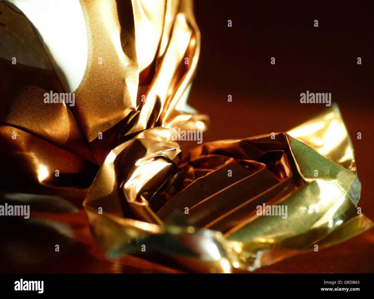 Crumpled Chocolates Paper, Candy Wrappers - Stock Image