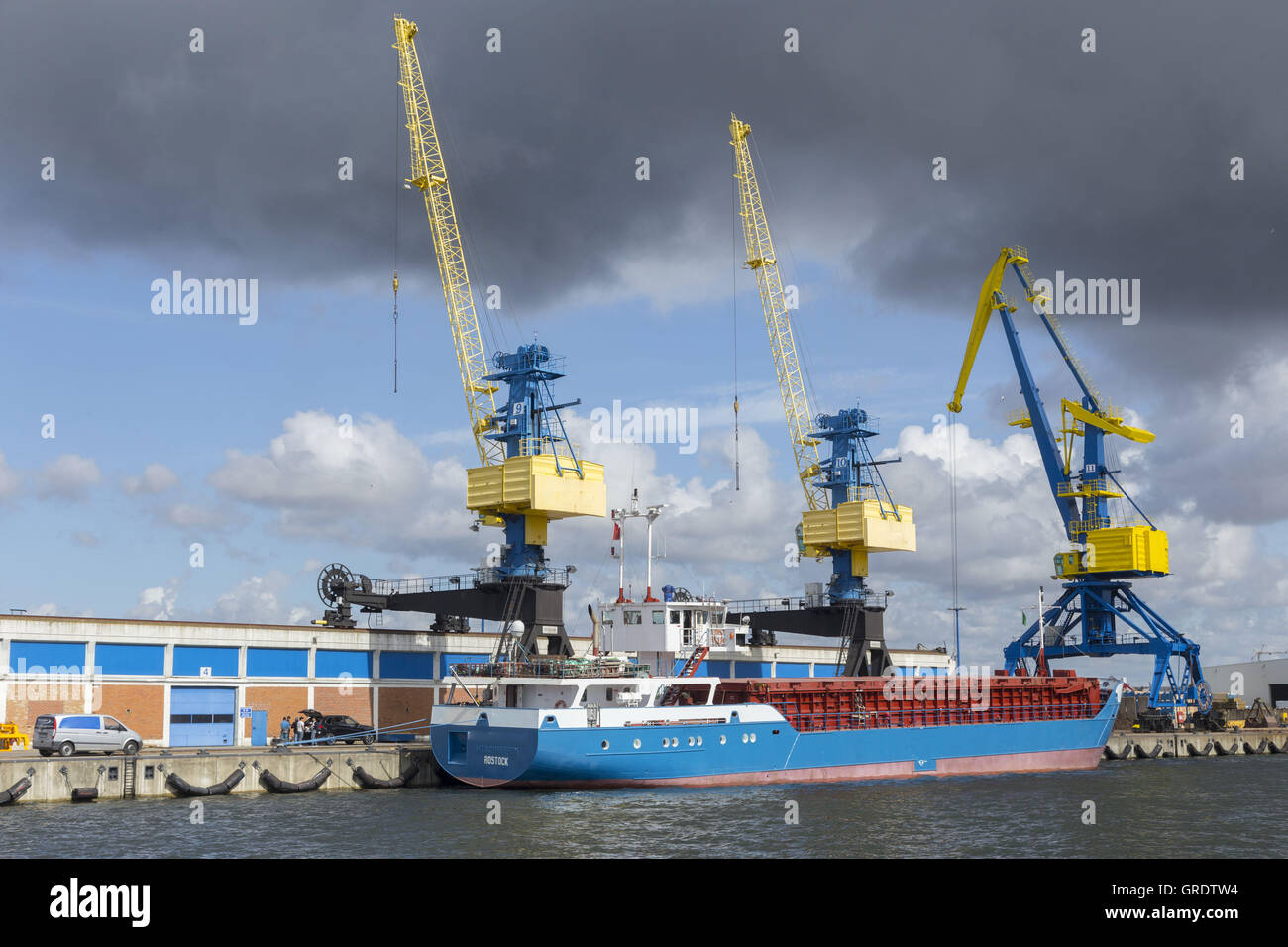 Three Large Industrial Cranes In The Port Of Wismar Mecklenburg-Vorpommern - Stock Image